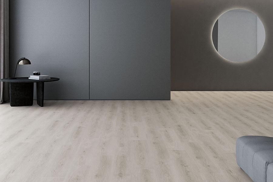tarima flotante con vetas de color blanco y gris en dormitorio de diseño